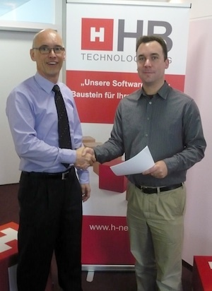 Steffen Huttner and Richard Holland exchange contracts in Tubingen.